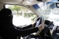 A Saudi woman drives through Riyadh, Saudi Arabia, 28 October 2013, during a campaign to end the ban on women drivers. Photo: EPA