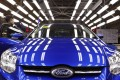 A worker on an assembly line at a Ford plant in Chongqing. Vice-Premier Wang Yang says China needs to shift investment focus to the service sectors, the central and western regions and to high value-added sectors. Photo: Reuters