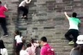Pictures circulating online show adults and children climbing the Zhengding city wall. Photo: Handout