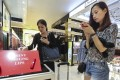 Despite the prevalence of smartphones in Hong Kong, people have been slow to take up mobile payments. Photo: Edward Wong