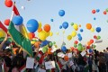 People hold balloons in protest of a flight ban at Arbil International Airport. The Iraqi government has imposed a ban on international flights in Iraq's Kurdish region after its non-binding independence referendum which has been strongly rejected by Iraq's central government, Iran and Turkey. Photo: EPA