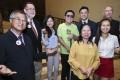 Winners of the Spirit of Hong Kong Awards (left to right): David Cheung Wai-sun; Professor Robert Bauer; Emily Tang; Comma Chan Hin-wang (on behalf of Theatre in the Dark); Chin Pui-chun (front yellow); Douglas Shum Hong-yuen (on behalf of Light of Raphael); Elli Fu Nga-nei (front white); and Father John David Wotherspoon. Photo: Edmond So