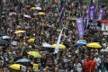 The protesters fanned out across a street in Causeway Bay on Sunday. Photo: Sam Tsang