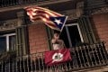 A man waves an 'Estelada' (Pro-independence Catalan flag) from a balcony in Barcelona. Photo: AFP Photo