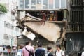 Residents of a Hong Kong tenement building miraculously escaped injury after part of the floor of their flat collapsed on June 21. Photo: Felix Wong