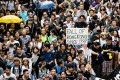 Protesters march in Hong Kong on July 1 this year, the 20th anniversary of the city's handover from British to Chinese rule. Photo: AFP