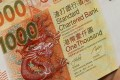 Regulators in Europe and Asia are believed to be investigating Standard Chartered, one of Hong Kong's three currency issuing institutions, over the role staff may have played in transferring US$1.4 billion of private bank client assets from the island of Guernsey to Singapore, before new tax transparency rules were introduced. Photo: SCMP