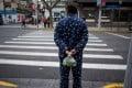 A man wearing pyjamas in Shanghai. Picture: AFP