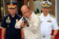 Philippine Defence Secretary Delfin Lorenzana inspects a rifle given to the Philippines by China. Photo: Reuters