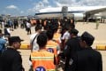 Chinese citizens suspected of an internet scam line up at Phnom Penh's international airport to be deported. Photo: AP