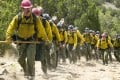 Josh Brolin (front) plays the chief of a team of firefighters in Only the Brave (category IIA) directed by .Joseph Kosinski