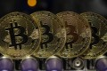 Despite their frothy valuations, cryptocurrencies are unlikely to become a mainstream means of exchange, according to UBS analysts. Photo: Bloomberg