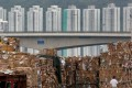 Tonnes of waste paper to be shipped to mainland China is piled up at a dock in Hong Kong, on September 15, after stricter requirements for waste imports into the mainland were announced. Photo: Reuters