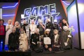 Cosplayers dressing up as characters from the video game Nier wait for judging at Singapore's GameStart Asia convention.