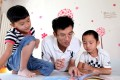 Zhang Qiaofeng reads a story to his son Hongwu (left), and student Zhou Jiebin in 2012 soon after Zhang gave up his successful career as the head of a medical research firm to home school his child. Photo: Simon Song