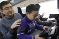 A child uses an iPad on a train in China. Picture: Xinhua