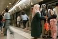 Passengers board a Singapore Mass Rapid Transit train. Photo: AFP