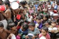 Rohingya children wait outside a food centre to collect lunch at a camp in Bangladesh on October 11. Photo: EPA
