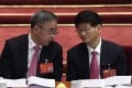 Guangdong party secretary Hu Chunhua (left) chats with fellow Politburo member Meng Jianzhu at the opening session of the Communist Party's national congress at the Great Hall of the People in Beijing on Wednesday. Photo: AFP