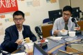 (L to R) Freed student leaders Joshua Wong and Nathan Law eating breakfast at the broadcast room during their interview with Commercial Radio, where they spoke about their 69-day confinement. Photo: David Wong