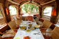 The dining area in a luxury houseboat in Alappuzha. Pictures: Alamy