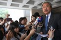 Former financial secretary John Tsang speaks outside the High Court on Thursday. Photo: Sam Tsang