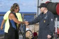 USS Ashland Command Master Chief Gary Wise welcomes aboard Jennifer Appel aboard after her rescue on Wednesday. Photo: AP