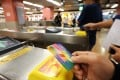 Octopus cards were first used for public transport but can now be used at convenience stores, car parks and other locations. Photo: Felix Wong