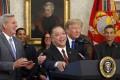 President Donald J. Trump hugs Broadcom CEO Hock Tan as Tan announces the repatriation of his company to the United States. Broadcom has announced a near hostile takeover bid for Qualcomm. Photo: Abaca Press/TNS