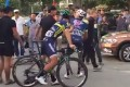 A confrontation breaks out as Wang Xin picks up his bike following the fall. Photos: YouTube