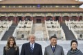 Melania Trump, US President Donald Trump, Chinese President Xi Jinping and his wife Peng Liyuan tour the Forbidden City in Beijing on Wednesday. Photo: AFP