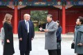 Chinese President Xi Jinping (second from right) and his wife Peng Liyuan (right) welcome US President Donald Trump and his wife Melania to the Forbidden City in Beijing on Wednesday. Photo: Xinhua