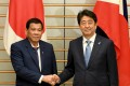 Philippines President Rodrigo Duterte shakes hands with Japanese Prime Minister Shinzo Abe. Japan is said to be building radar stations for the Southeast Asian nation to fight off pirates. Photo: AFP