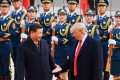 China's President Xi Jinping and US President Donald Trump outside the Great Hall of the People in Beijing, China. Photo: TNS