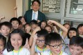 Principal Alan Chow with pupils at W F Joseph Lee Primary School. Photo: K. Y. Cheng