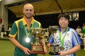 Jesse Noronha and Vivian Yip show off their trophies after winning their singles final on Sunday. Photo: Handout