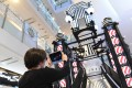 French artist Nicolas Buffe uses augmented reality to reveal images in his looming rocket lantern sculpture at K11 Mall.