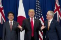 Japanese Prime Minister Shinzo Abe, US President Donald Trump and Australian Prime Minister Malcolm Turnbull meet during the Asean Summit in Manila on Monday. Abe first raised the idea of the Quad 10 years ago. Photo: AP