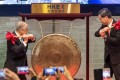 Chow Chung Kong, chairman of HKEX, left, and Leung Chun-ying, Hong Kong's then-chief executive, strike a gong at the launch ceremony of the Shenzhen-Hong Kong Stock Connect on December 5, 2016. Photo: Bloomberg