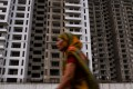 Incomplete residential flats in Greater Noida, some 25 kilometres southeast of India's capital New Delhi. Analysts see the country's cash ban and new regulations to protect buyers as putting a damper on a recovery in property prices. Photo: AFP