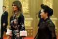 Melania Trump, wife of the US president, and Peng Liyuan, wife of China's president, arrive for a state dinner at the Great Hall of the People in Beijing on Thursday. Photo: Reuters