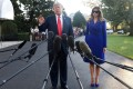 US president Donald Trump with first lady Melania Trump answering questions from the media before departing the White House for Hawaii. Photo: TNS