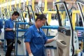 A production line inside a factory of SAIC-GM-Wuling, in Liuzhou, China. Photo: Reuters