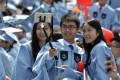 Chinese students attend a graduation ceremony at Columbia University in 2015. According to the latest Open Doors report, the rate of growth of Chinese enrolments at US colleges is slowing. Photo: Xinhua