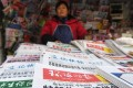 A file picture of a vendor selling newspapers in Beijing. All areas of the media in China are state-controlled or face routine oversight from government censors. Photo: Agence France-Presse
