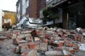 Debris from a nearby building lies on a street in Pohang, North Gyeongsang Province, South Korea. Photo: EPA