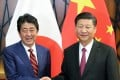 Japanese Prime Minister Shinzo Abe and Chinese President Xi Jinping shake hands before talks in Da Nang, Vietnam, on November 11. Photo: Kyodo