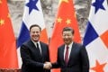 Panama's President Juan Carlos Varela met Xi Jinping for a signing ceremony in Beijing on Friday. Photo: Reuters