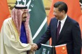 Chinese President Xi Jinping (right) and Saudi Arabia's King Salman shake hands at Beijing's Great Hall of the People in March. Photo: Kyodo