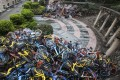 Broken bicycles were piled up next to Xiashan Park of Shenzhen city. Photo Imaginechina
